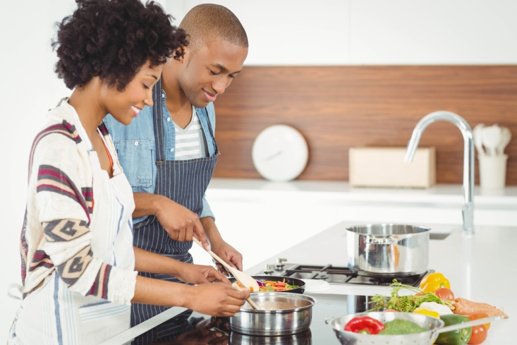 Image of couple cooking in the kitchen